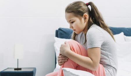 Criança com dor, automutilação